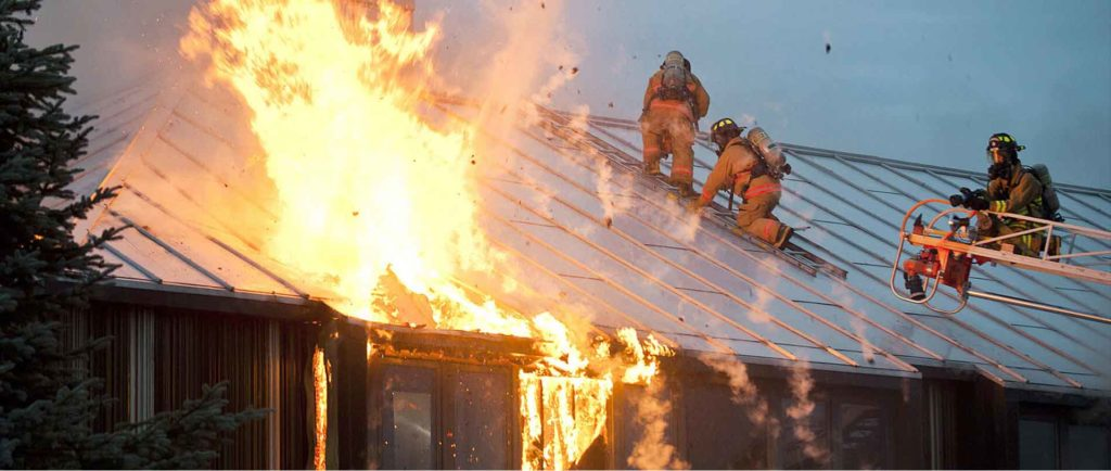 Firefighters on a flaming roof