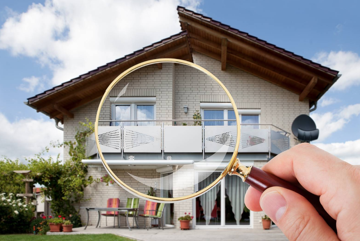 Image of a home being examined with a magnifying glass