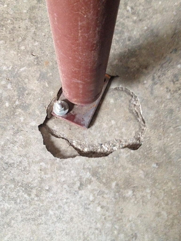 Floor deflection at post. This is why an engineer needs to inspect the slab to ensure it is strong enough to take the weight of the post or column. If not, a footing needs to be installed