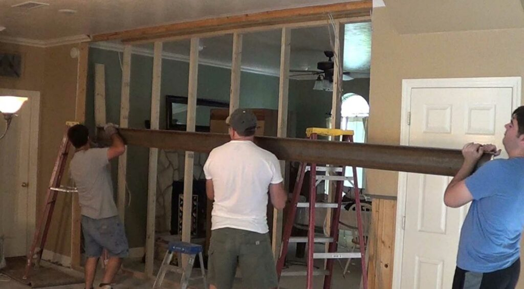 Contractors removing a load bearing wall