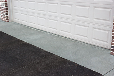 A concrete garage apron extending 3 feet outside of a garage door