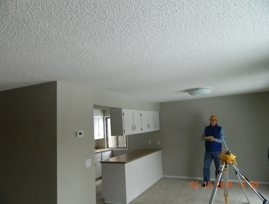 Cabinets and soffit demonstrate significant sagging.